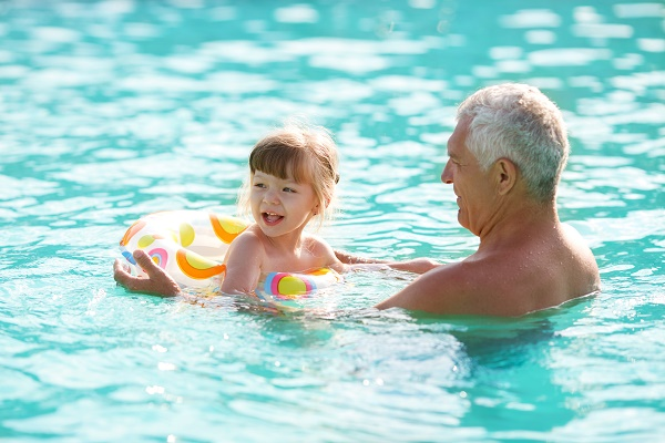 Is it easy to teach a child to swim?